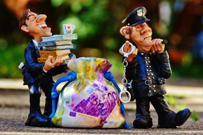 taxes-tax-evasion-police-handcuffs.jpg